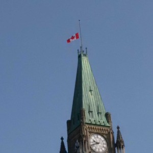 The flag atop the Peace Tower flies at half mast in honour of the late Honourable William Jarvis