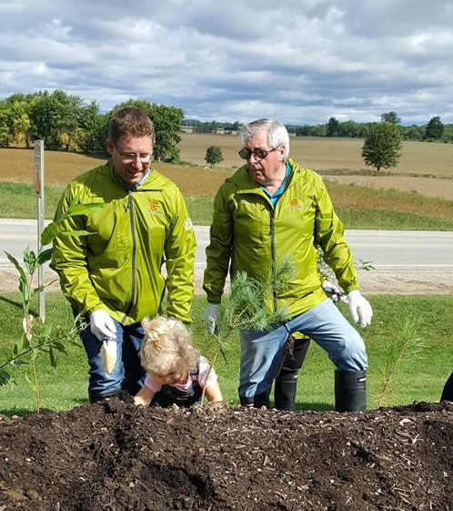 M.P. Nater tree planting in Palmerston with Wellington County Warden George Bridge and his daughter Ainsley