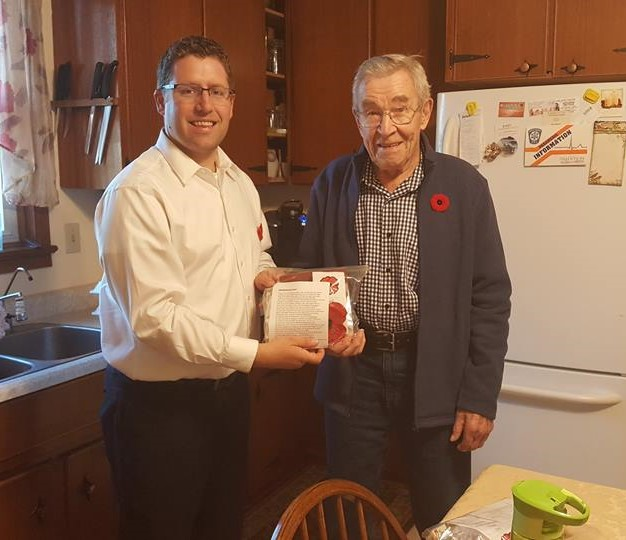 M.P. Nater delivering meals to veteran Merv Leonhardt for the Mitchell Legion